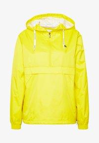 ESSENTIAL POP OVER - Windbreaker - solar yellow