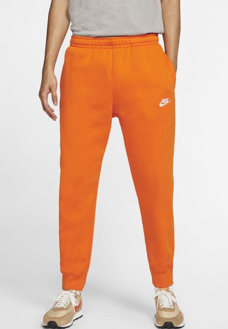 Nike Sportswear - CLUB - Tracksuit bottoms - magma orange/white