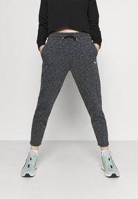 Puma - EVOSTRIPE PANTS - Tracksuit bottoms - black heather - 0