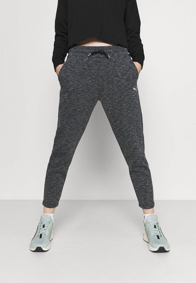 Puma - EVOSTRIPE PANTS - Tracksuit bottoms - black heather