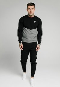 SIKSILK - CUT AND SEW JOGGERS - Pantalon de survêtement - black - 0