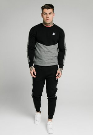 CUT AND SEW JOGGERS - Verryttelyhousut - black
