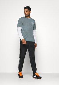 Nike Performance - FC TEE SEASONAL - Print T-shirt - smoke grey - 1