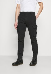 Calvin Klein Jeans - WASHED PANT - Cargo trousers - black - 0