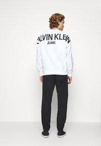 Calvin Klein Jeans - TRACK PANT - Trousers - black - 2