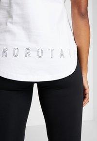 MOROTAI - NAKA LOGO BASIC TANK - Top - white - 3