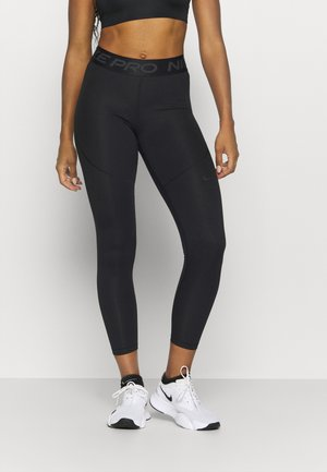 WARM TIGHT ESSENTIAL - Leggings - black/smoke grey