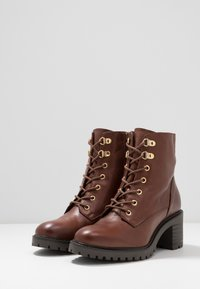 KIOMI - Lace-up ankle boots - brown - 4