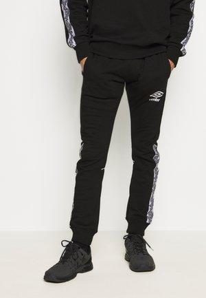 TAPED JOGGER - Pantalones deportivos - black