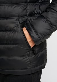 Superdry - COMMUTER QUILTED BIKER - Light jacket - jet black