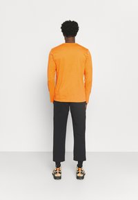 The North Face - HIMALAYAN BOTTLE SOURCE - Long sleeved top - orange - 2