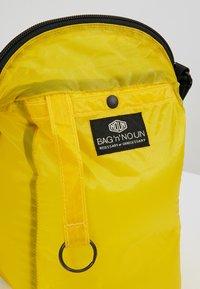 Bag N Noun - CAMP POCHETTE HALF - Across body bag - yellow - 7
