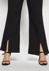 Noisy May Curve - NMSKYLER SLIT PANTS - Trousers - black - 6