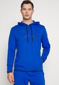 Calvin Klein Underwear - HOODIE - Camiseta de pijama - blue - 0
