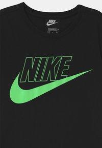 Nike Sportswear - FUTURA  - Vestito di maglina - black/vapor green - 2