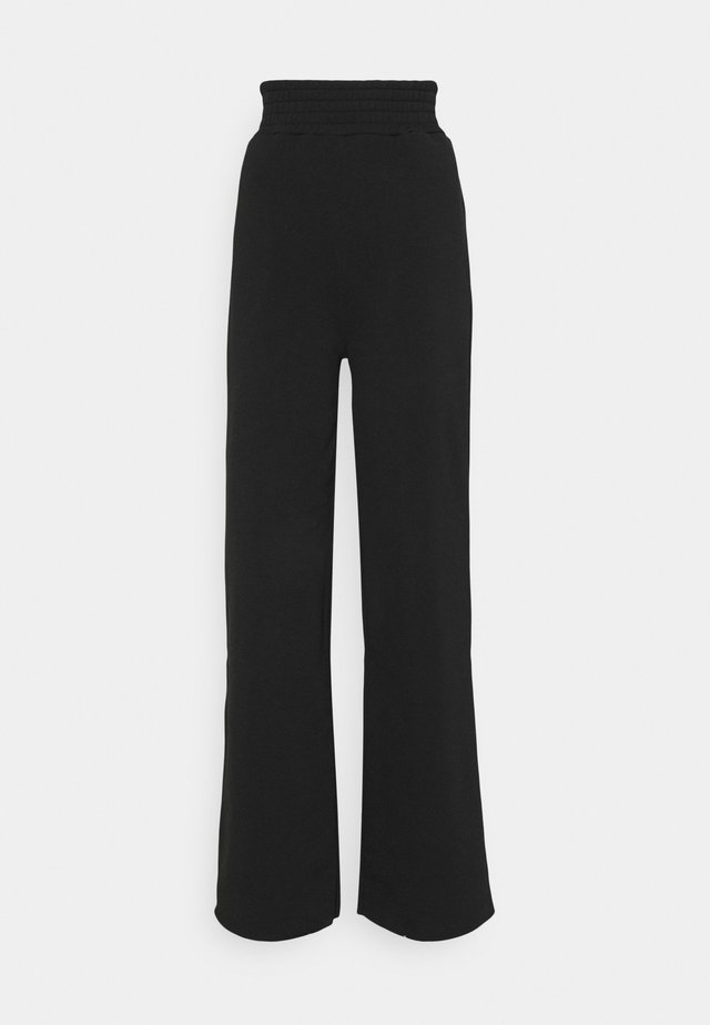 K AND K FLARE HIGH RISE - Pantaloni sportivi - black