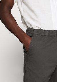 Jack & Jones - JJIVEGA JJJOGGER - Trousers - dark grey - 4