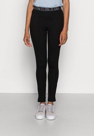 MILANO LOGO ELASTIC - Leggings - Trousers - black