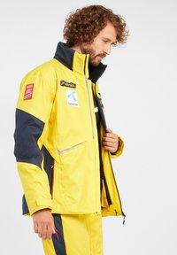 Phenix - Snowboardjas - golden yellow mit logos - 5