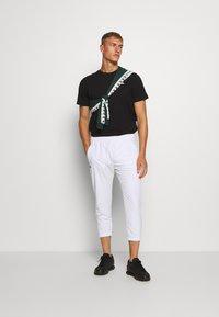 Kappa - HAUKE TEE - Basic T-shirt - caviar - 1