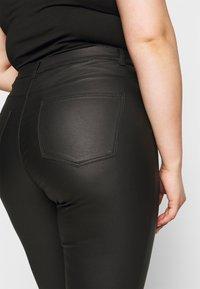 JUNAROSE - by VERO MODA - JRFOUR COATED PANTS - Jeans Skinny Fit - black - 5