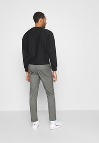 Calvin Klein Tailored - MOULINE GRID TAPERED PANTS - Trousers - khaki - 2