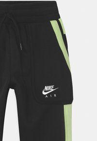 Nike Sportswear - AIR - Pantalones deportivos - black/light liquid lime/white - 2