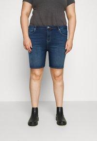 ONLY Carmakoma - CARLAOLA LIFE - Denim shorts - medium blue denim - 0