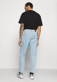 Karl Kani - RINSE PANTS - Relaxed fit jeans - light blue - 2