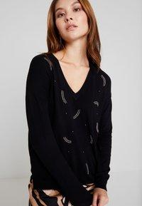 NAF NAF - Stickad tröja - noir - 4