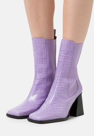 High heeled ankle boots - malva