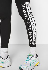 Calvin Klein Jeans - MIRRORED LOGO - Leggings - Trousers - black - 3