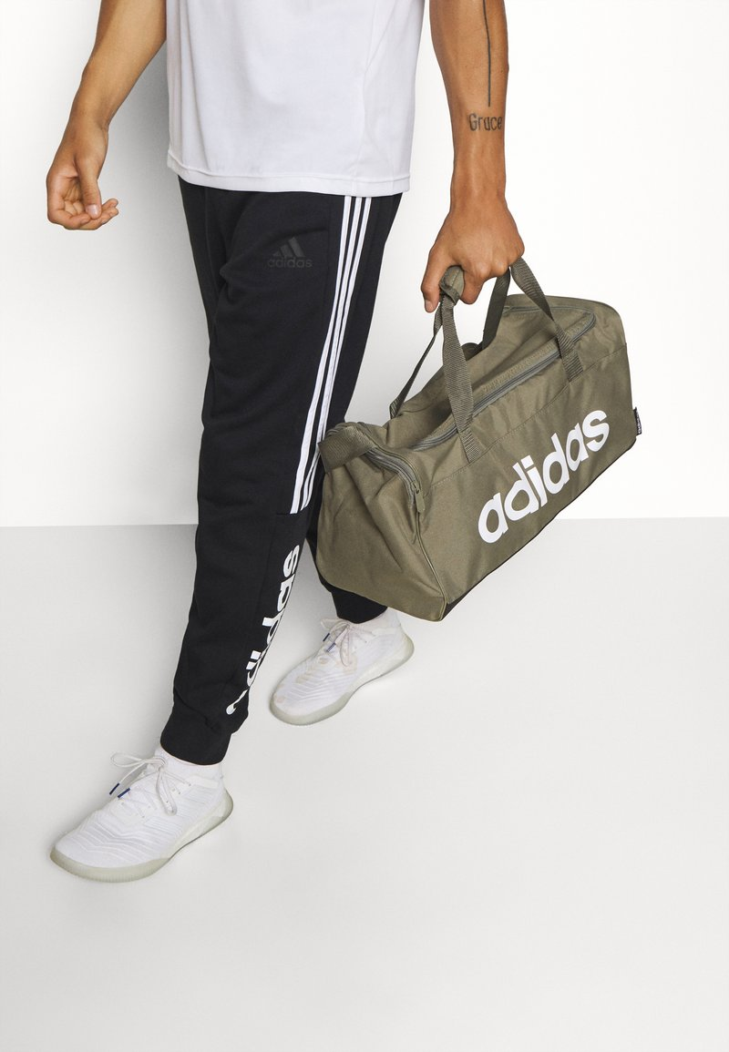 adidas Performance - ESSENTIALS LINEAR SPORT DUFFEL BAG UNISEX - Sportväska - green
