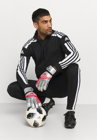 adidas Performance - SQUAD - Tracksuit bottoms - black/white - 1