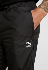 Puma - TREND PANTS - Tracksuit bottoms - black/houndstooth - 5