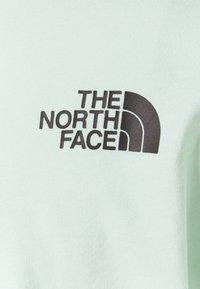 The North Face - CROP TEE - Print T-shirt - misty jade - 6