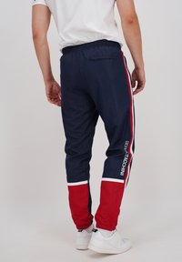 sergio tacchini - BULK - Tracksuit bottoms - nvy/appred - 2