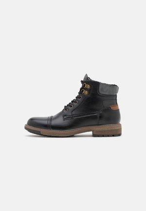 VEGAN LANDONN - Lace-up ankle boots - black
