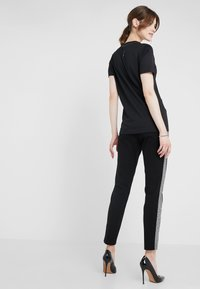 Escada Sport - TAMIANNE - Trousers - black - 2