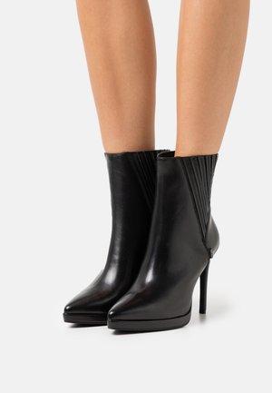 BEVERLEY - Platform ankle boots - black