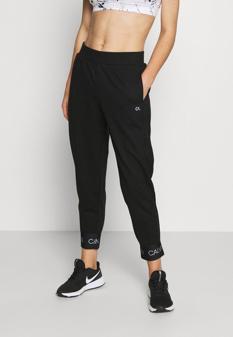Calvin Klein Performance - Tracksuit bottoms - black