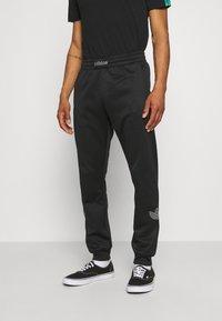 adidas Originals - Träningsbyxor - black - 0