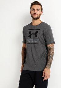 Under Armour - FOUNDATION - Print T-shirt - charcoal medium heather/graphite/black - 0