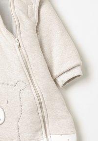 Jacky Baby - MIT ABNEHMBAREN ÄRMELN HELLO WORLD - Baby's sleeping bag - beige melange - 4
