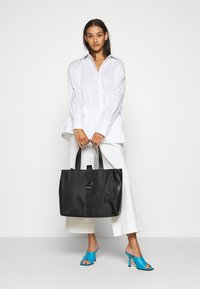 Tommy Jeans - MODERN TWIST TOTE - Tote bag - black - 0