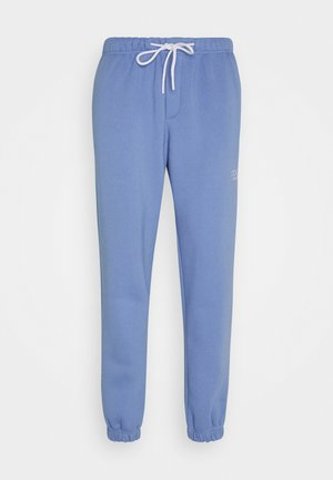 TRADEMARK PANTS - Tracksuit bottoms - ice blue
