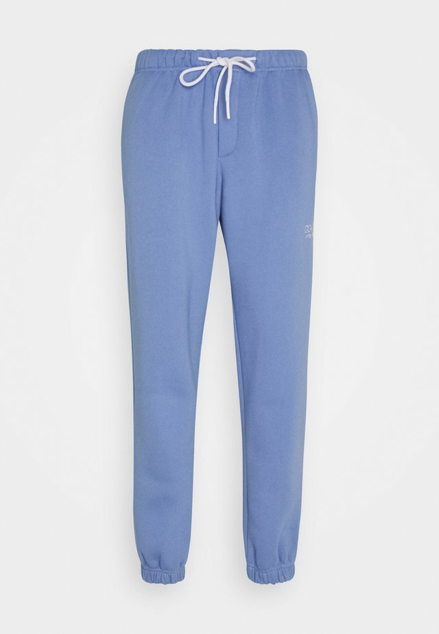 TRADEMARK PANTS - Trainingsbroek - ice blue