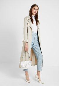 New Look - SHARNI SADDLE BAG - Handbag - white - 1