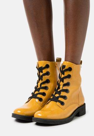 Lace-up ankle boots - saffron