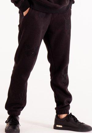 DRAG CLOUD - Tracksuit bottoms - black